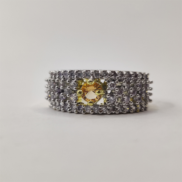 Silver ring with Golden stone